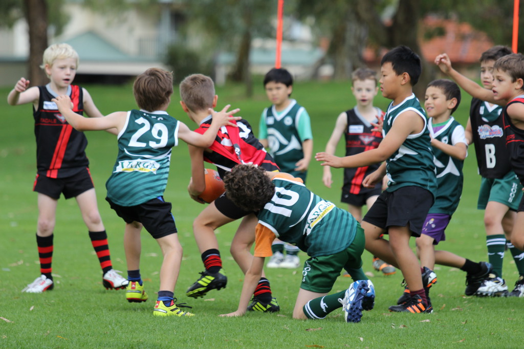 Alex, Cambell and Jordan tackling an Attadale player