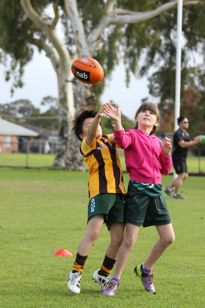 Jayden and Amelie compete for a mark