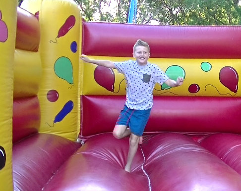 Jeremy on the bouncy castle