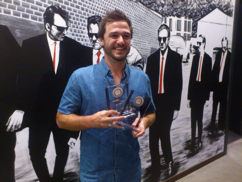 Josh Catalano holding both awards